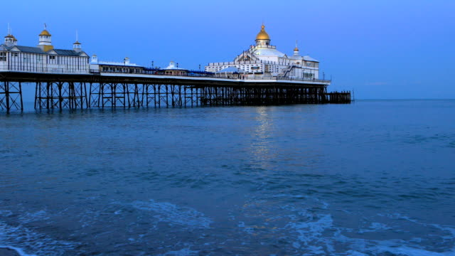 4k:eastbourne pier west sussex with beach and wave - pier stock videos & royalty-free footage