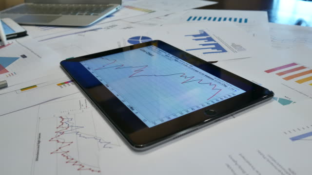 4k:financial analysts see charts and graphs on the screen of the touchpad - touchpad stock videos & royalty-free footage