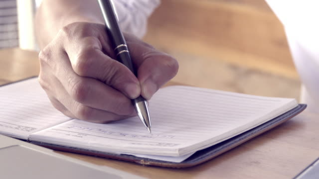 4k,hand of businessman writing on paper in office - ballpoint pen stock videos & royalty-free footage