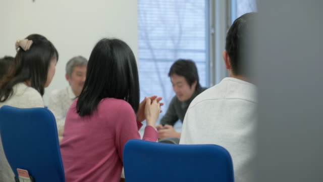 4k,japanese businessmen and businesswomen having a meeting. - business meeting stock videos & royalty-free footage