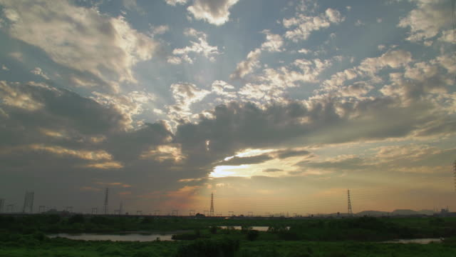 4k,kakogawa river and sunset,kakogawa,hyogo,japan - electricity pylon stock videos & royalty-free footage