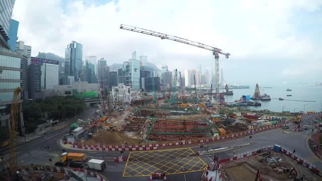 4 K: 香港 kong(Timelapse) の複合ビルに取り組んでいくつかのクレーンを含む大規模な工事現場