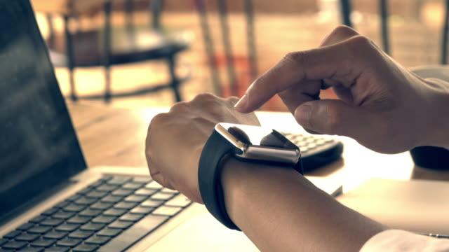 4k,man using his smart watch app. Close-up hands