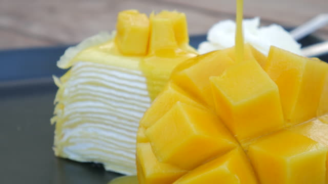 4k:mango cheese cake with fresh mango sauce - mango stock videos & royalty-free footage
