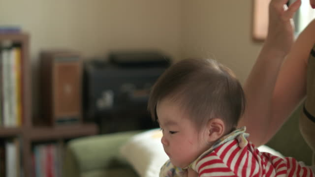4k,mother using laptop with baby. - japanese mom stock videos & royalty-free footage