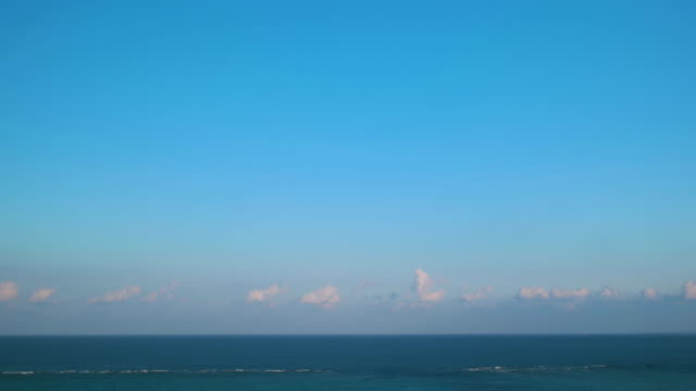 4k,ocean and sky.okinawa,japan - wolkenloser himmel stock-videos und b-roll-filmmaterial