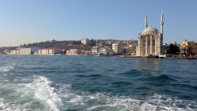 4k:ortakoy mosque from sea side, istanbul - ortakoy mosque stock videos and b-roll footage