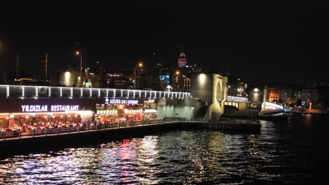 4k:people on the galata bridge - istanbul stock videos & royalty-free footage