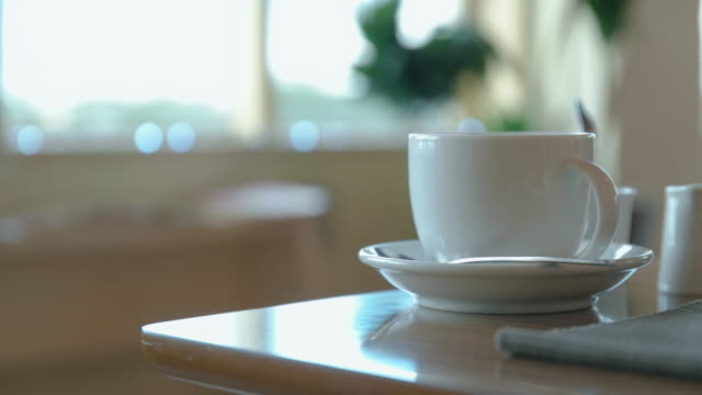 4K,Selective focus shot of a Cup on table.