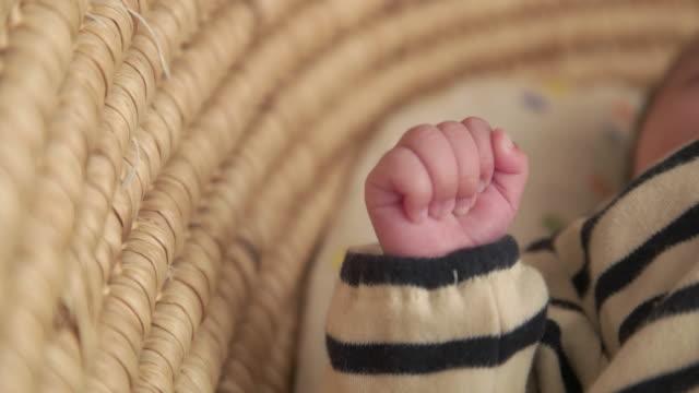 4k,selective focus shot of japanese newborn baby hand. - babygro stock videos & royalty-free footage