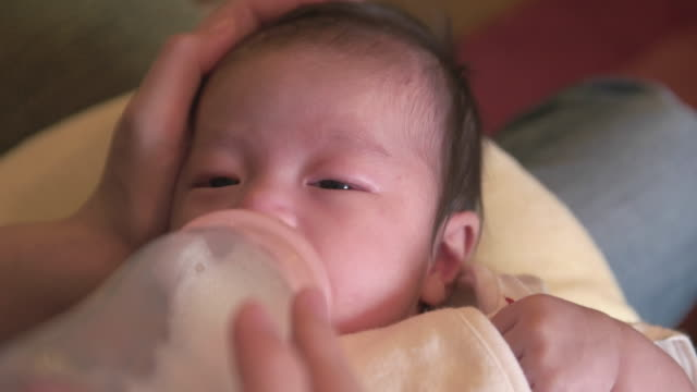 4k,selective focuse, japanese baby girl (2month). - baby milk stock videos & royalty-free footage