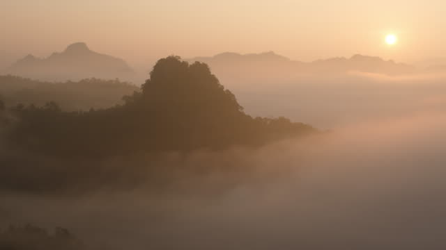 4k:sunrise in the morning and wave of cloud on mountain - roll over stock videos and b-roll footage