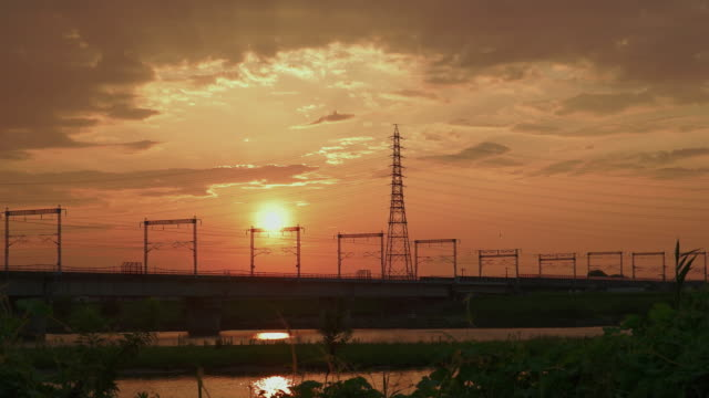 4k,sunset over kakogawa river,hyogo,japan - electricity pylon stock videos & royalty-free footage