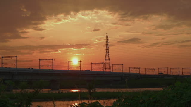 4k,sunset view and bullet train passing.kakogawa,hyogo,japan - electricity pylon stock videos & royalty-free footage