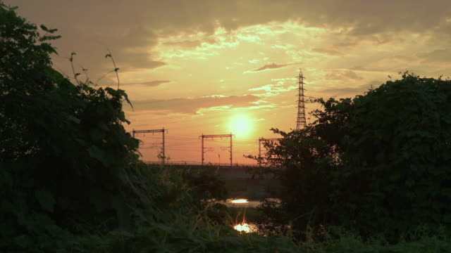 4k,sunset view from reverbank at kakogawa,hyogo,japan - electricity pylon stock videos & royalty-free footage