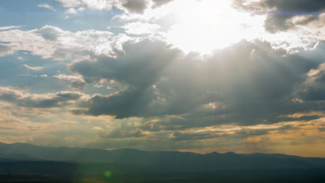 4k:sunset with rays of light - atmospheric mood stock videos & royalty-free footage