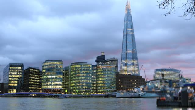 4k:thames, shard and the city hall in london, england, uk - shard london bridge stock videos & royalty-free footage