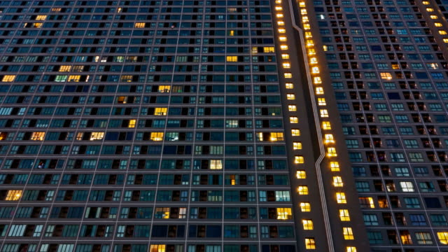 4ktime lapse day and night of urban resident building - illuminated stock videos & royalty-free footage