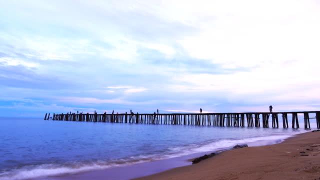 4k:time lapse of sunset at sea fishing bridge - pier stock videos & royalty-free footage