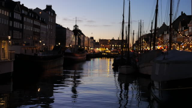 4k:timelapse of nyhavn in copenhagen, denmark at night time - copenhagen stock videos and b-roll footage