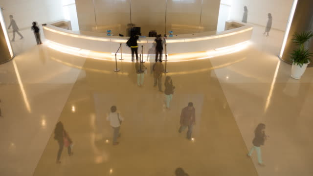 4k:timelapse of  walking people in corporate building - lobby stock videos & royalty-free footage