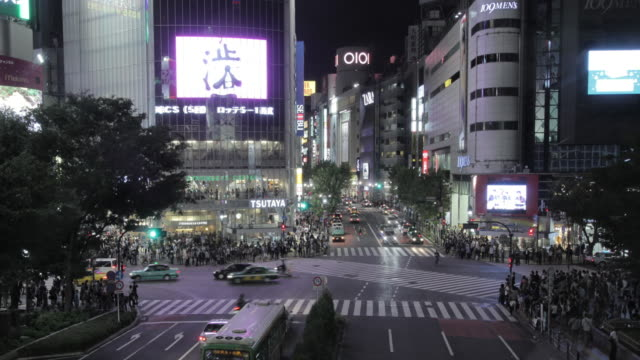 4k,tl,traffic in shibuya.tokyo,japan - electronic billboard stock videos and b-roll footage