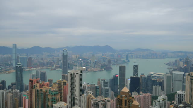 4k,view over Hong Kong cityscape,Island looking towards Victoria Peak showing the busy Victoria Harbour and Financial District of Central, Hong Kong, China,Hong Kong island skyline and pair of eagles flying over the city.