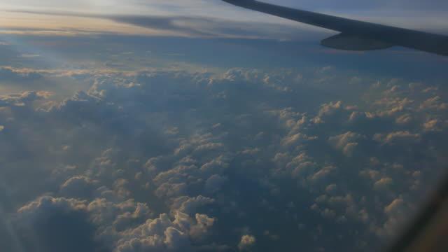 4K:View through airplane window above thailand