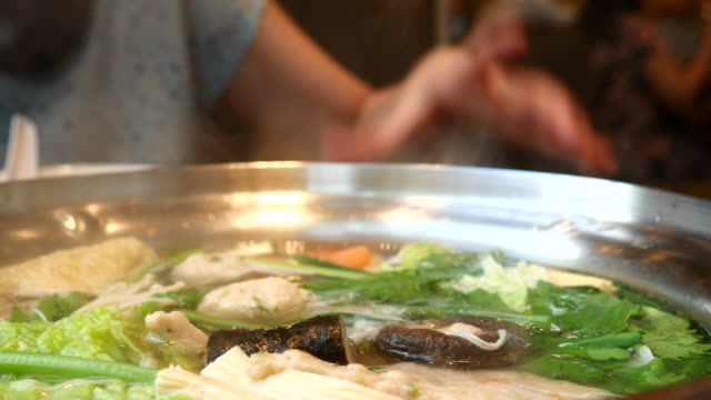 4k:yong woman pour into casserole dishes - sukiyaki stock videos and b-roll footage