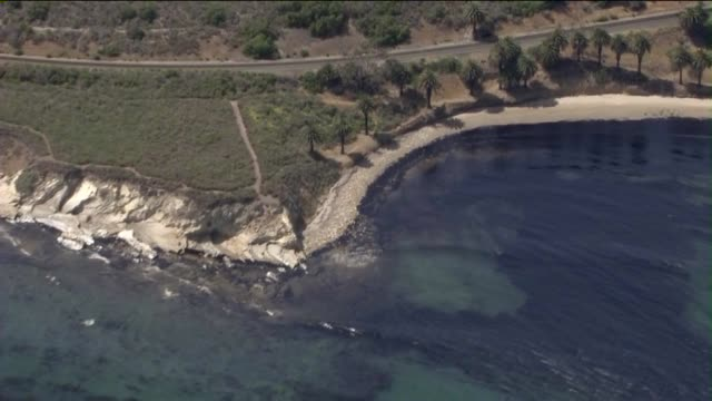ktla a 4milewide oil slick that poured from a ruptured pipeline into the waters off refugio state beach in santa barbara county on may 19 2015 - oil slick stock videos & royalty-free footage