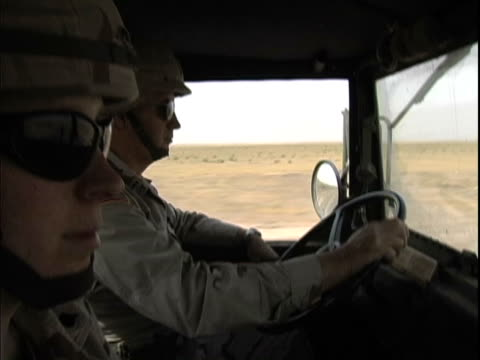 4th May 2005 MS Female and male US soldiers driving 5 ton truck cross country / Iraq / AUDIO