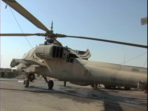 4th may 2005 montage ah64 apache caught in dust storm towed in for maintenance, soldier climbing out of apache / fob speicher, iraq / audio - one mid adult man only stock videos & royalty-free footage