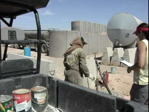 4th may 2005 montage civilian contractor at fuel point / fob speicher iraq / audio - one mid adult woman only stock videos & royalty-free footage