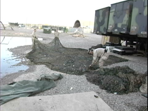 4th May 2005 WS US Soldiers going about day to day activities / FOB Speicher Iraq / AUDIO