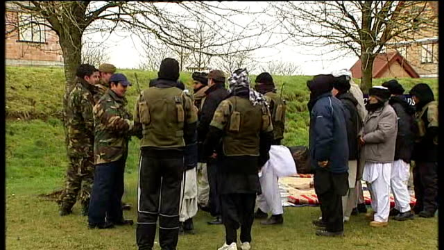 stockvideo's en b-roll-footage met 4th mechanized brigade train for afghanistan deployment england wiltshire salisbury plain ext officer briefing the press as afghans stand behind him... - wiltshire