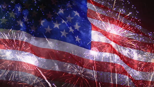 4th of july background with fireworks on waving usa flag, celebration independence day in america - firework display stock videos & royalty-free footage