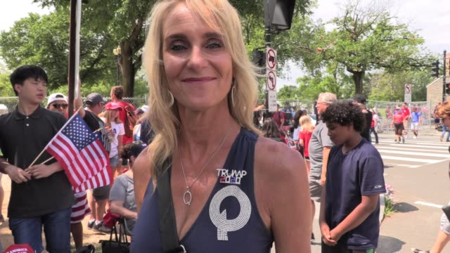 4th of july parade washington dc, woman with qanon pin explains far-right conspiracy theory. qanon - conspiracy stock videos & royalty-free footage