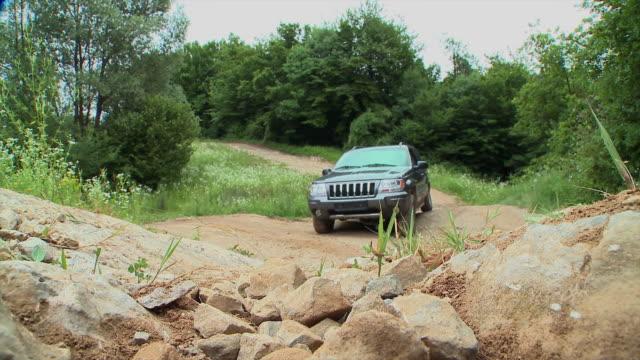 ws cu 4x4 car driving on dirt road, vrhnika, slovenia - vrhnika stock videos & royalty-free footage