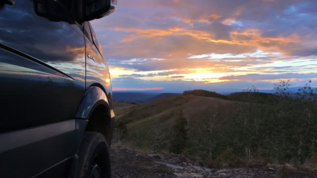 a 4x4 mercedesbenz sprinter van parked at the summit at sunset tourists are still engaging in outdoor activities amid the 2020 global coronavirus... - romantic sky stock videos & royalty-free footage
