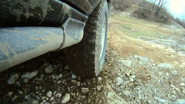hd: 4x4 tire while driving - dirt track stock videos & royalty-free footage
