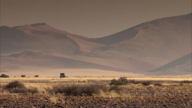 WS TS PAN 4x4 vehicle driving in desert / Sossusvlei, Namibia