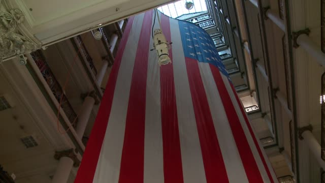 by-100-foot hanging flag — the world's largest american flag to be displayed inside a department store — was hung in macy's courtyard to honor... - biggest stock videos & royalty-free footage