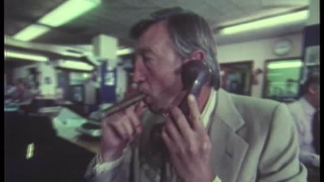 50th anniversary of news at ten; u03079202 date unknow sandy gall on phone in newsroom as smokes cigar, john suchet and carol barnes in newsroom with... - julie etchingham stock videos & royalty-free footage