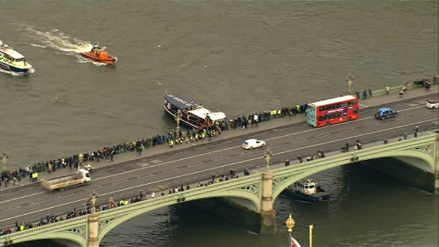 50th anniversary of Sir Winston Churchill funeral EXT Havengore barge and flotilla up river under Westminster Bridge past Houses of Parliament