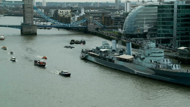 50th anniversary of Sir Winston Churchill funeral High angle shot of Havengore barge and flotilla passing HMS Belfast