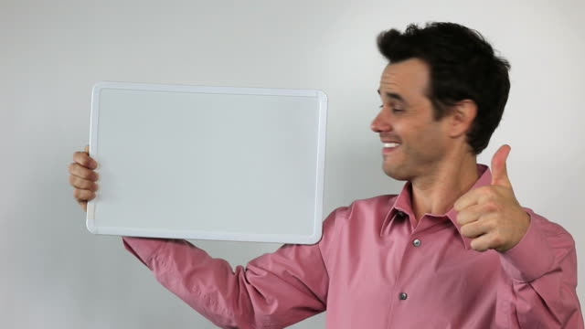 5.\tCharismatic Sales Guy Holding White Board, Thumbs Up!