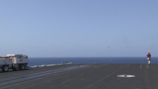 us 5th fleet area of responsibility sailors and marines gather on the flight deck of the aircraft carrier uss nimitz to view flight operations - catapult stock videos & royalty-free footage