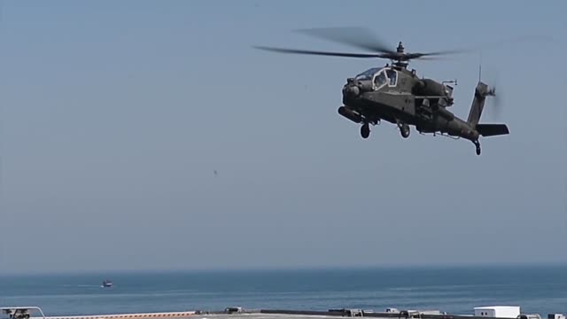 us 5th fleet area of responsibility us army uh60 black hawk helicopters and ah64d apache helicopter assigned to 36th combat aviation brigade conduct... - black hawk helicopter stock videos and b-roll footage