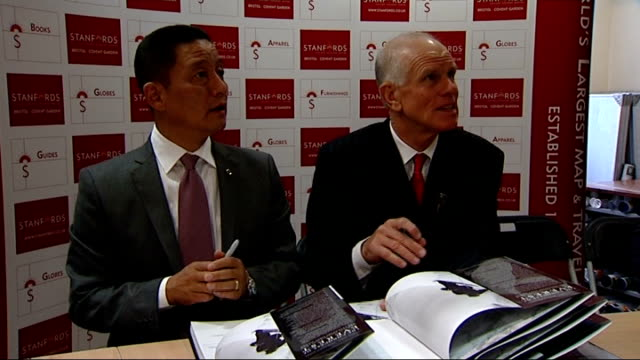 60th anniversary of the first ascent of mount everest; england: london: int peter hillary and jamling tenzing sitting together at book signing in... - tenzing norgay stock videos & royalty-free footage