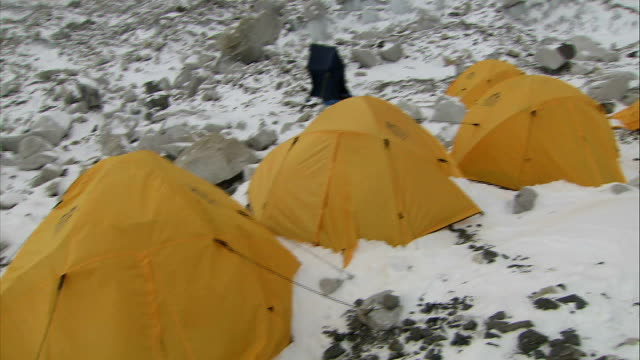 60th anniversary of the first ascent of mount everest; r02120907 / 2.12.2009 nepal: himalayas: mount everest: yellow tents pitched at everest base... - base camp stock videos & royalty-free footage